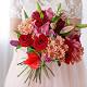 Букет из: красная лента — 1 шт., роза (красный, 50 см) — 11 шт., хризантема кустовая (коралловый) — 5 шт., тюльпан (фиолетовый) — 7 шт., лилия ветка (белый) — 3 шт. - Букет с тюльпанами, лилией, розами - фото 3